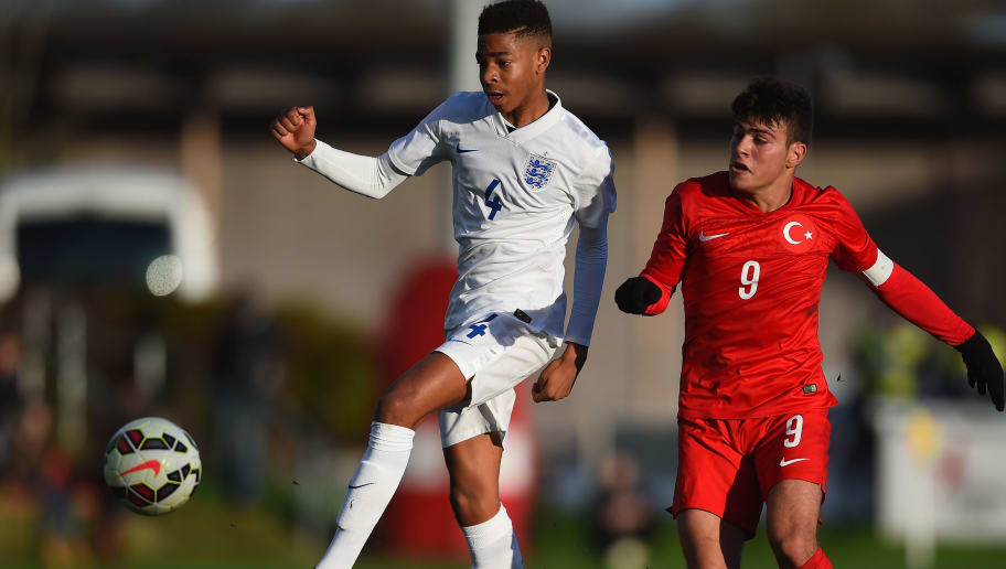 BURTON-UPON-TRENT, ENGLAND - DECEMBER 21:  Elijah Dixon-Bonner of England battles with Ali Yavuz Kol of Turkey during the International Friendly match between England U15 and Turkey U15 at St George's Park on December 21, 2015 in Burton-upon-Trent, England.  (Photo by Laurence Griffiths/Getty Images)