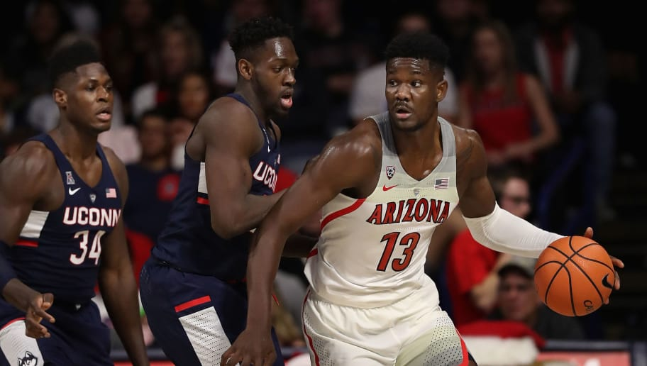 TUCSON, AZ - DECEMBER 21:  Deandre Ayton #13 of the Arizona Wildcats handles the ball during the second half of the college basketball game against the Connecticut Huskies at McKale Center on December 21, 2017 in Tucson, Arizona. The Wildcats defeated the Huskies 73-58.  (Photo by Christian Petersen/Getty Images)