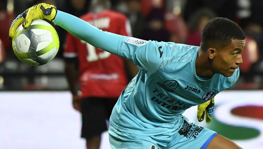 Toulouse's French goalkeeper Alban Lafont throws the ball back into play during the French L1 football match Guingamp vs Toulouse on September 30, 2017 at the Roudourou stadium in Guingamp. / AFP PHOTO / DAMIEN MEYER        (Photo credit should read DAMIEN MEYER/AFP/Getty Images)