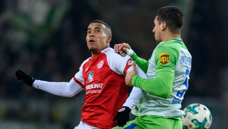 MAINZ, GERMANY - FEBRUARY 23: Robin Quaison of Mainz in action against Marciano Bruma of Wolfsburg during the Bundesliga match between 1. FSV Mainz 05 and VfL Wolfsburg at Opel Arena on February 23, 2018 in Mainz, Germany. (Photo by Alexander Scheuber/Bongarts/Getty Images)