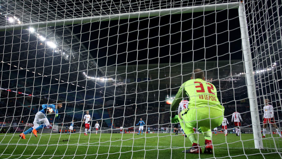 LEIPZIG, GERMANY - FEBRUARY 22: Lorenzo Insigne (L) of Napoli celebartes after scoring his team's second goal against goalkeeper Peter Gulacsi (R) of Leipzig during the UEFA Europa League Round of 32 match between RB Leipzig and Napoli at the Red Bull Arena on February 22, 2018 in Leipzig, Germany. (Photo by Ronny Hartmann/Bongarts/Getty Images)