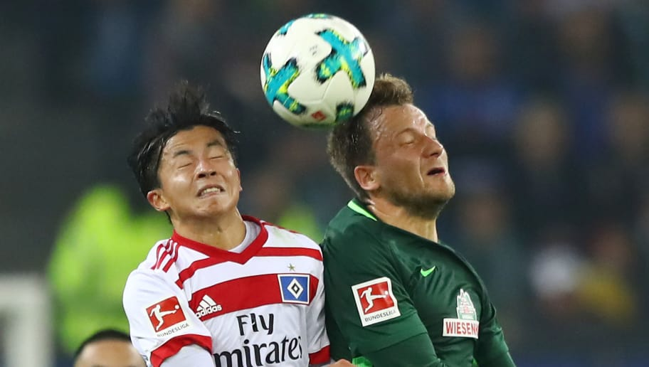 HAMBURG, GERMANY - SEPTEMBER 30: Tatsuya Ito of Hamburg (l) fights for the ball with Philipp Bargfrede of Bremen during the Bundesliga match between Hamburger SV and SV Werder Bremen at Volksparkstadion on September 30, 2017 in Hamburg, Germany. (Photo by Martin Rose/Bongarts/Getty Images)