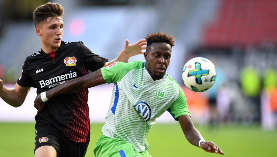 Wolfsburg's Belgian forward Divock Origi (R) and Leverkusen´s defender Panagiotis Retsos vie for the ball during the German first division Bundesliga football match Bayer Leverkusen vs VfL Wolfsburg in Leverkusen, western Germany, on October 15, 2017. / AFP PHOTO / PATRIK STOLLARZ / RESTRICTIONS: DURING MATCH TIME: DFL RULES TO LIMIT THE ONLINE USAGE TO 15 PICTURES PER MATCH AND FORBID IMAGE SEQUENCES TO SIMULATE VIDEO. == RESTRICTED TO EDITORIAL USE == FOR FURTHER QUERIES PLEASE CONTACT DFL DIRECTLY AT + 49 69 650050         (Photo credit should read PATRIK STOLLARZ/AFP/Getty Images)
