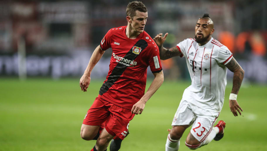 LEVERKUSEN, GERMANY - Sven Bender #5 of Bayer Leverkusen and Arturo Vidal #23 of Bayern Munich battle for the ball during the Bundesliga match between Bayer 04 Leverkusen and FC Bayern Muenchen at BayArena on January 12, 2018 in Leverkusen, Germany. (Photo by Maja Hitij/Bongarts/Getty Images)