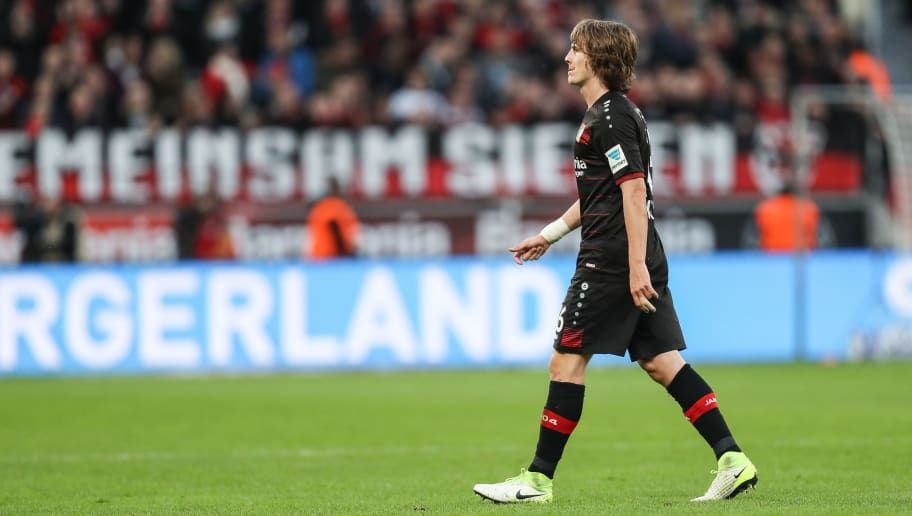 LEVERKUSEN, GERMANY - APRIL 15: Tin Jedvaj of Leverkusen walks off the pitch after receiving a red card from referee during the Bundesliga match between Bayer 04 Leverkusen and Bayern Muenchen at BayArena on April 15, 2017 in Leverkusen, Germany. (Photo by Maja Hitij/Bongarts/Getty Images)