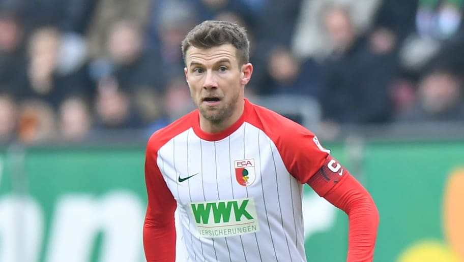 AUGSBURG, GERMANY - FEBRUARY 18: Daniel Baier of Augsburg plays the ball during the Bundesliga match between FC Augsburg and VfB Stuttgart at WWK-Arena on February 18, 2018 in Augsburg, Germany. (Photo by Sebastian Widmann/Bongarts/Getty Images)