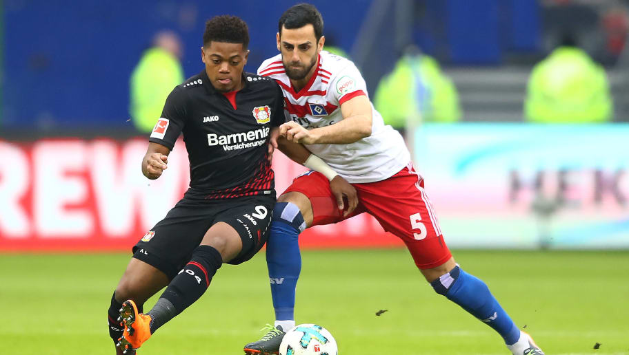 HAMBURG, GERMANY - FEBRUARY 17: Leon Bailey of Bayer Leverkusen (l) fights for the ball with Mergim Mavraj of Hamburg during the Bundesliga match between Hamburger SV and Bayer 04 Leverkusen at Volksparkstadion on February 17, 2018 in Hamburg, Germany. (Photo by Martin Rose/Bongarts/Getty Images)