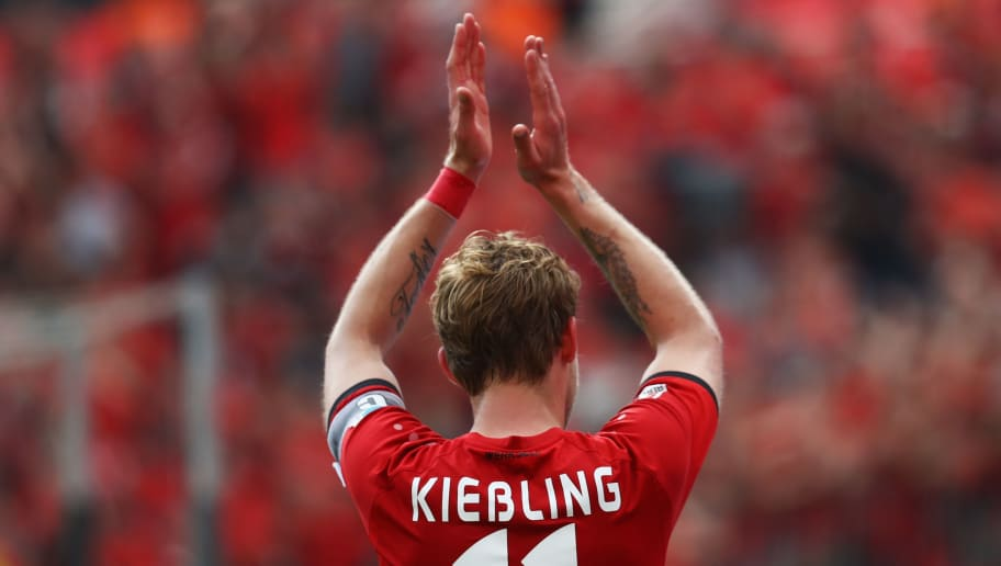 LEVERKUSEN, GERMANY - MAY 13:  Captain, Stefan Kiessling of Bayer 04 Leverkusen celebrates in front of the home fans after the Bundesliga match between Bayer 04 Leverkusen and 1. FC Koeln at BayArena on May 13, 2017 in Leverkusen, Germany.  (Photo by Dean Mouhtaropoulos/Bongarts/Getty Images)