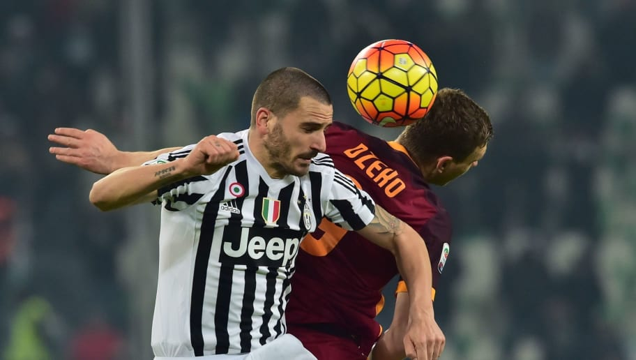 Juventus' defender from Italy Leonardo Bonucci (L) fights for the ball with Roma's forward from Bosnia-Herzegovina Edin Dzeko during  the Serie A match Juventus vs AS Roma at 'Juventus Stadium' in Turin on January 24 , 2016 . AFP PHOTO / GIUSEPPE CACACE / AFP / GIUSEPPE CACACE        (Photo credit should read GIUSEPPE CACACE/AFP/Getty Images)