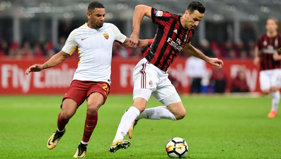 AS Roma's Brazilian defender Bruno Peres (L) vies with AC Milan's Croatian forward Nikola Kalinic during the Italian Serie A football match AC Milan vs AS Roma at the San Siro stadium in Milan on October 1, 2017. / AFP PHOTO / MIGUEL MEDINA        (Photo credit should read MIGUEL MEDINA/AFP/Getty Images)