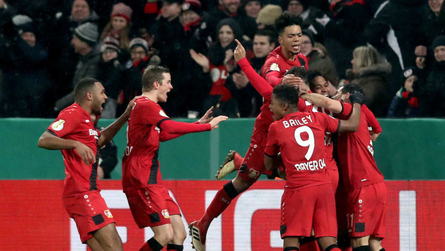 LEVERKUSEN, GERMANY - FEBRUARY 06: The team of Leverkusen comes celebrates the third goal scored by Karim Bellarabi during the DFB Cup quarter final match between Bayer Leverkusen and Werder Bermen at BayArena on February 6, 2018 in Leverkusen, Germany. (Photo by Christof Koepsel/Bongarts/Getty Images)