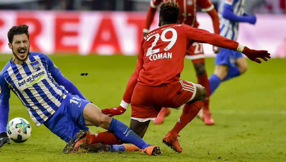 Bayern Munich's French striker Kingsley Coman (R) fouls Berlin's Australian midfielder Mathew Leckie  during the German first division Bundesliga football match Bayern Munich vs Hertha Berlin in Munich, southern Germany, on February 24, 2018. / AFP PHOTO / Guenter SCHIFFMANN / RESTRICTIONS: DURING MATCH TIME: DFL RULES TO LIMIT THE ONLINE USAGE TO 15 PICTURES PER MATCH AND FORBID IMAGE SEQUENCES TO SIMULATE VIDEO. == RESTRICTED TO EDITORIAL USE == FOR FURTHER QUERIES PLEASE CONTACT DFL DIRECTLY AT + 49 69 650050         (Photo credit should read GUENTER SCHIFFMANN/AFP/Getty Images)