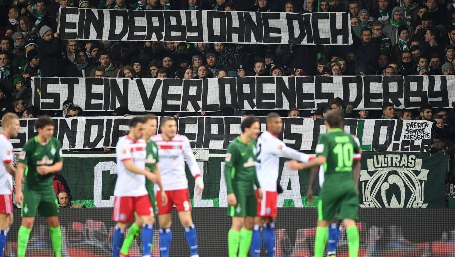 BREMEN, GERMANY - FEBRUARY 24: Fans display a banner about the derby during the Bundesliga match between SV Werder Bremen and Hamburger SV at Weserstadion on February 24, 2018 in Bremen, Germany. (Photo by Stuart Franklin/Bongarts/Getty Images)