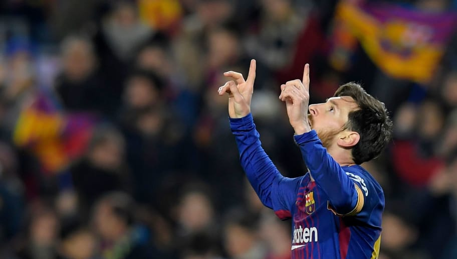 Barcelona's Argentinian forward Lionel Messi celebrates after scoring during the Spanish league football match between FC Barcelona and Girona FC at the Camp Nou stadium in Barcelona on February 24, 2018. / AFP PHOTO / LLUIS GENE        (Photo credit should read LLUIS GENE/AFP/Getty Images)