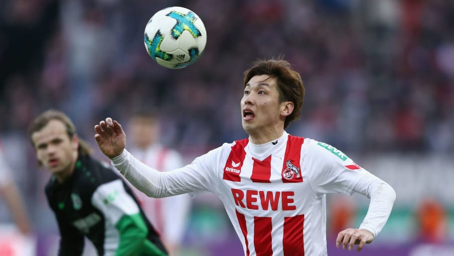 COLOGNE, GERMANY - FEBRUARY 17:  Yuya Osako of Koeln is challenged by Iver Fossum of Hannover during the Bundesliga match between 1. FC Koeln and Hannover 96 at RheinEnergieStadion on February 17, 2018 in Cologne, Germany.  (Photo by Alex Grimm/Bongarts/Getty Images)