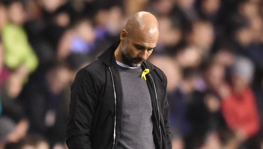 WIGAN, ENGLAND - FEBRUARY 19:  Josep Guardiola, Manager of Manchester City looks dejected during the Emirates FA Cup Fifth Round match between Wigan Athletic and Manchester City at DW Stadium on February 19, 2018 in Wigan, England.  (Photo by Michael Regan/Getty Images)