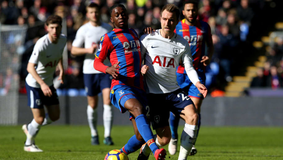 LONDON, ENGLAND - FEBRUARY 25:  Christian Eriksen of Tottenham Hotspur and Aaron Wan-Bissaka of Crystal Palace in action during the Premier League match between Crystal Palace and Tottenham Hotspur at Selhurst Park on February 25, 2018 in London, England.  (Photo by Steve Bardens/Getty Images)