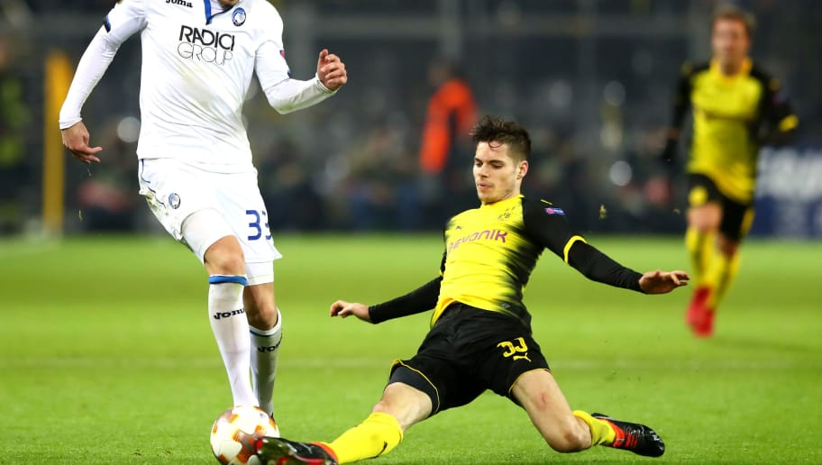 DORTMUND, GERMANY - FEBRUARY 15:  Hans Hateboer of Atalanta is tackled by Julian Weigl of Borussia Dortmund during UEFA Europa League Round of 32 match between Borussia Dortmund and Atalanta Bergamo at the Signal Iduna Park on February 15, 2018 in Dortmund, Germany.  (Photo by Martin Rose/Bongarts/Getty Images)