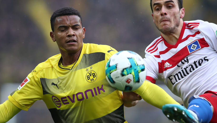 DORTMUND, GERMANY - FEBRUARY 10: Manuel Akanji of Dortmund (l) fights for the ball with Filip Kostic of Hamburg during the Bundesliga match between Borussia Dortmund and Hamburger SV at Signal Iduna Park on February 10, 2018 in Dortmund, Germany. (Photo by Oliver Hardt/Bongarts/Getty Images)