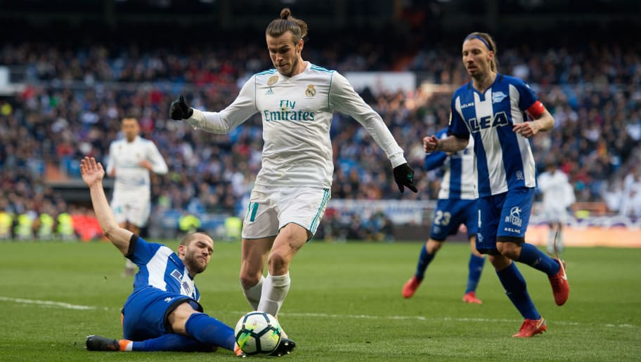MADRID, SPAIN - FEBRUARY 24: Gareth Bale of Real Madrid is brought down by Victor Laguardia of Deportivo Alaves during the La Liga match between Real Madrid and Deportivo Alaves at Estadio Santiago Bernabeu on February 24, 2018 in Madrid, Spain. Real were awarded a penalty kick which was converted by Karim Benzema for their 4th goal. (Photo by Denis Doyle/Getty Images)