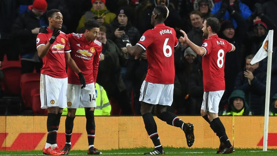 MANCHESTER, ENGLAND - JANUARY 15:  Anthony Martial of Manchester United celebrates scoring his side's second goal with team mates during the Premier League match between Manchester United and Stoke City at Old Trafford on January 15, 2018 in Manchester, England.  (Photo by Michael Regan/Getty Images)
