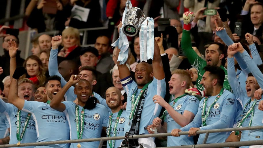 LONDON, ENGLAND - FEBRUARY 25:  Vincent Kompany of Manchester City lifts the trophy after winning the Carabao Cup Final between Arsenal and Manchester City at Wembley Stadium on February 25, 2018 in London, England.  (Photo by Catherine Ivill/Getty Images)