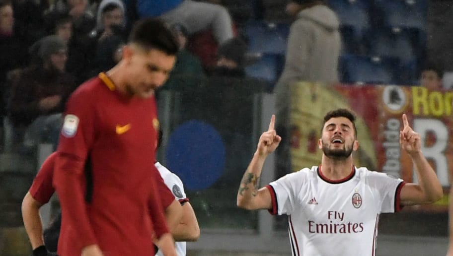 AC Milan's Italian forward Patrick Cutrone celebrates after scoring a goal during the Italian Serie A football match Roma versus Milan at the Olympic Stadium in Rome. / AFP PHOTO / Andreas SOLARO        (Photo credit should read ANDREAS SOLARO/AFP/Getty Images)