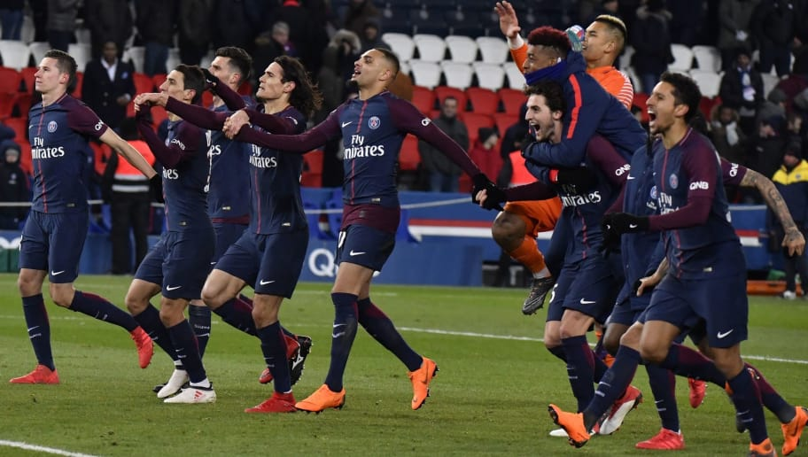 Paris Saint-Germain's players celebrate after winning after the French L1 football match between Paris Saint-Germain (PSG) and Marseille (OM) at the Parc des Princes in Paris on February 25, 2018. / AFP PHOTO / GERARD JULIEN        (Photo credit should read GERARD JULIEN/AFP/Getty Images)