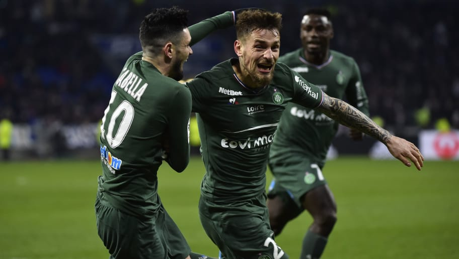Saint-Etienne's French defender Mathieu Debuchy (R) celebrates with Saint-Etienne's French forward Remy Cabella (L) after scoring a goal during the French L1 football match between Lyon (OL) and Saint-Etienne (ASSE) on February 25, 2018, at the Groupama stadium in Decines-Charpieu near Lyon, central-eastern France.   / AFP PHOTO / ROMAIN LAFABREGUE        (Photo credit should read ROMAIN LAFABREGUE/AFP/Getty Images)
