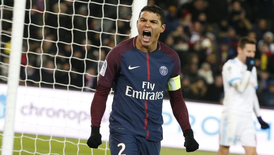 Paris Saint-Germain's Brazilian defender Thiago Silva celebrates after saving the ball during the French L1 football match between Paris Saint-Germain (PSG) and Marseille (OM) at the Parc des Princes in Paris on February 25, 2018.  / AFP PHOTO / GEOFFROY VAN DER HASSELT        (Photo credit should read GEOFFROY VAN DER HASSELT/AFP/Getty Images)