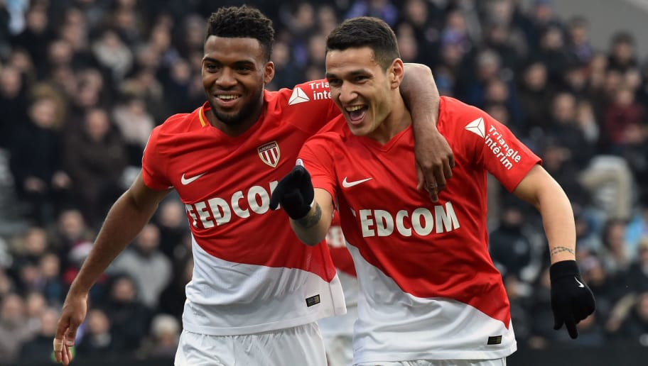 Monaco's Portuguese forward Rony Lopes celebrates with his teammate Monaco's French midfielder Thomas Lemar after scoring a goal during the French L1 football match Toulouse against Monaco February 24, 2018 at the Municipal Stadium in Toulouse, southern France.   / AFP PHOTO / PASCAL PAVANI        (Photo credit should read PASCAL PAVANI/AFP/Getty Images)