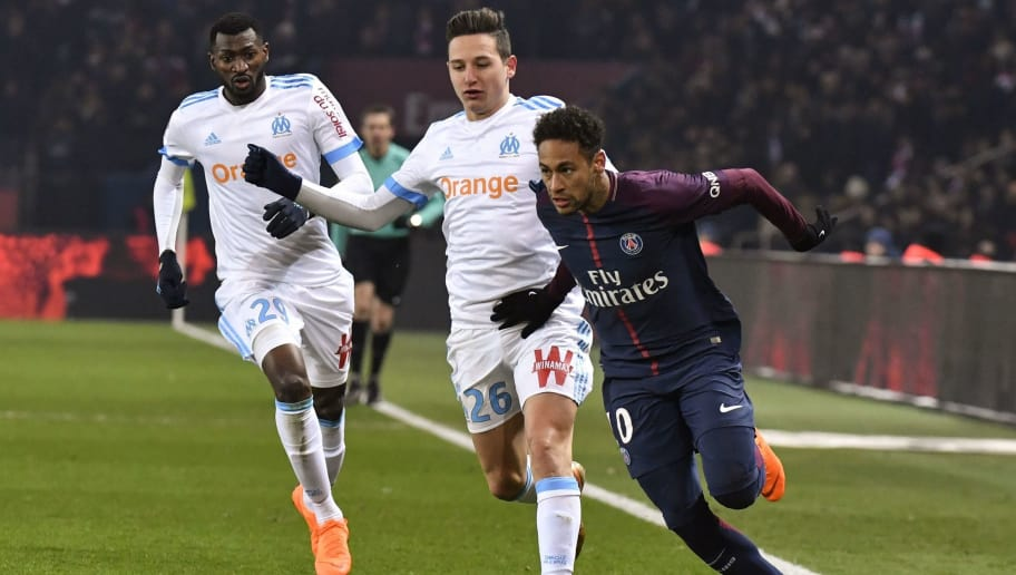 Paris Saint-Germain's Brazilian forward Neymar Jr (R) vies with Marseille's French forward Florian Thauvin (C) and Marseille's French midfielder Andre-Frank Zambo Anguissa during the French L1 football match between Paris Saint-Germain (PSG) and Marseille (OM) at the Parc des Princes in Paris on February 25, 2018.  / AFP PHOTO / GERARD JULIEN        (Photo credit should read GERARD JULIEN/AFP/Getty Images)