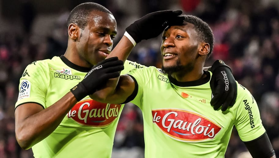 Angers' Cameroun forward Karl Toko Ekambi (R) is congratulated by a teammate after scoring a goal during the French L1 football match Lille vs Angers on February 24 2018 at the Pierre Mauroy stadium in Villeneuve d'Ascq, northern France. / AFP PHOTO / PHILIPPE HUGUEN        (Photo credit should read PHILIPPE HUGUEN/AFP/Getty Images)