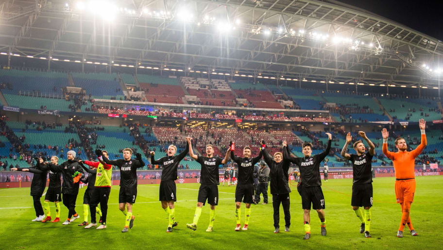 Cologne´s players celebrate after winning the German first division Bundesliga football match RB Leipzig vs FC Cologne in Leipzig, eastern Germany, on February 25, 2018. / AFP PHOTO / ROBERT MICHAEL / RESTRICTIONS: DURING MATCH TIME: DFL RULES TO LIMIT THE ONLINE USAGE TO 15 PICTURES PER MATCH AND FORBID IMAGE SEQUENCES TO SIMULATE VIDEO. == RESTRICTED TO EDITORIAL USE == FOR FURTHER QUERIES PLEASE CONTACT DFL DIRECTLY AT + 49 69 650050         (Photo credit should read ROBERT MICHAEL/AFP/Getty Images)