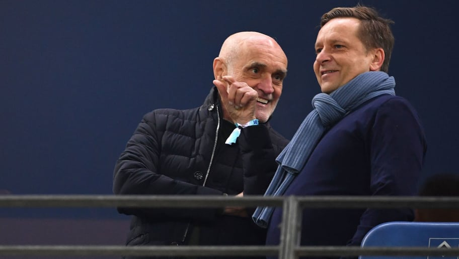 HAMBURG, GERMANY - FEBRUARY 04:  Martin Kind, president of Hannover and Horst Heldt, sports director of Hannover discuss during the Bundesliga match between Hamburger SV and Hannover 96 at Volksparkstadion on February 4, 2018 in Hamburg, Germany.  (Photo by Stuart Franklin/Bongarts/Getty Images)