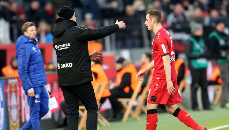 LEVERKUSEN, GERMANY - FEBRUARY 25:  (L-R) Head coach Heiko Herrlich cares of Dominik Kohr of Leverkusen after being sent off the pitch getting a yellow red card during the Bundesliga match between Bayer 04 Leverkusen and FC Schalke 04 at BayArena on February 25, 2018 in Leverkusen, Germany. (Photo by Christof Koepsel/Bongarts/Getty Images)