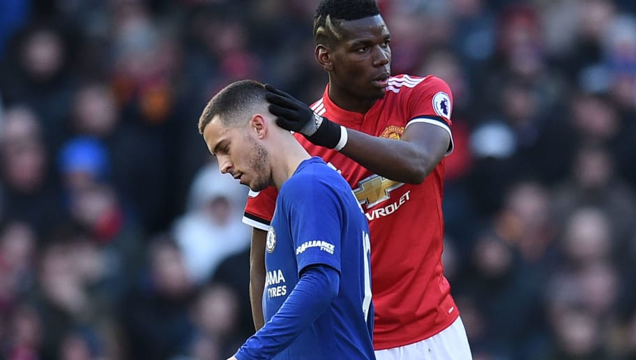 Manchester United's French midfielder Paul Pogba (R) gestures to Chelsea's Belgian midfielder Eden Hazard as Hazard is substituted during the English Premier League football match between Manchester United and Chelsea at Old Trafford in Manchester, north west England, on February 25, 2018. / AFP PHOTO / Oli SCARFF / RESTRICTED TO EDITORIAL USE. No use with unauthorized audio, video, data, fixture lists, club/league logos or 'live' services. Online in-match use limited to 75 images, no video emulation. No use in betting, games or single club/league/player publications.  /         (Photo credit should read OLI SCARFF/AFP/Getty Images)