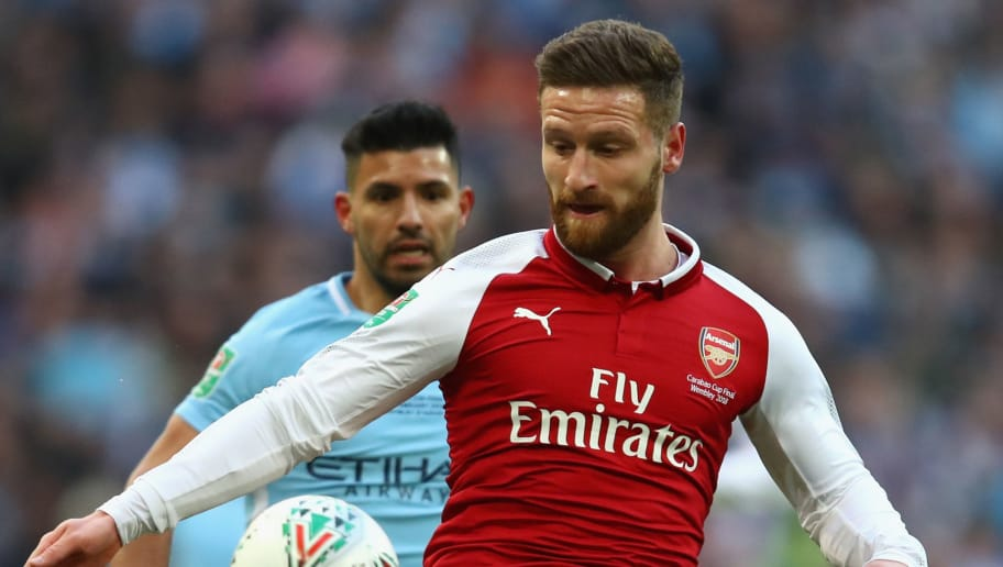 LONDON, ENGLAND - FEBRUARY 25:  Shkodran Mustafi of Arsenal under pressure from Sergio Aguero of Manchester City during the Carabao Cup Final between Arsenal and Manchester City at Wembley Stadium on February 25, 2018 in London, England.  (Photo by Julian Finney/Getty Images)