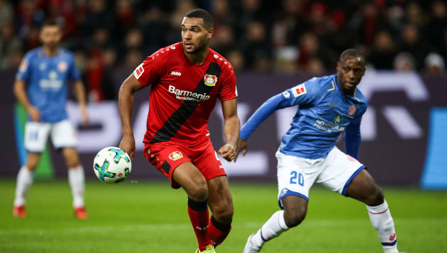 LEVERKUSEN, GERMANY - JANUARY 28: Jonathan Tah #4 of Bayer Leverkusen and Antony Ujah #20 of FSV Mainz 05 battle for the ball during the Bundesliga match between Bayer 04 Leverkusen and 1. FSV Mainz 05 at BayArena on January 28, 2018 in Leverkusen, Germany. (Photo by Maja Hitij/Bongarts/Getty Images)