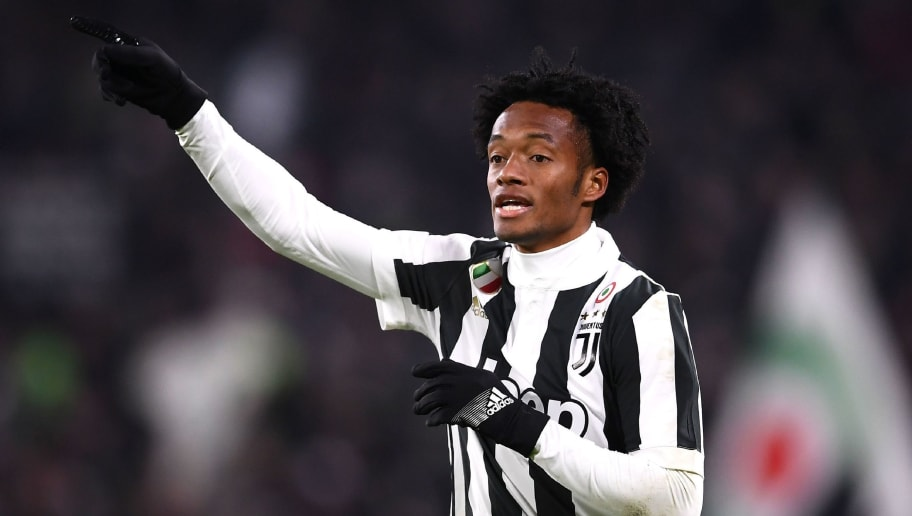 Juventus' midfielder Juan Cuadrado from Colombia gestures during the Italian Serie A football match Juventus vs Inter Milan on December 9, 2017 at the Allianz stadium in Turin. / AFP PHOTO / MARCO BERTORELLO        (Photo credit should read MARCO BERTORELLO/AFP/Getty Images)