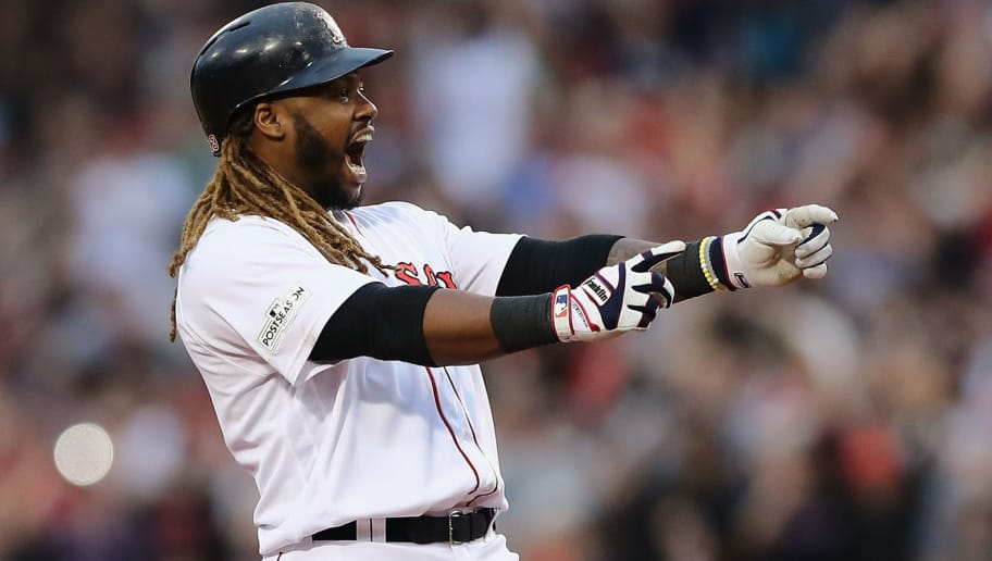 BOSTON, MA - OCTOBER 08:  Hanley Ramirez #13 of the Boston Red Sox celebrates after hitting a two-run RBI double in the seventh inning against the Houston Astros during game three of the American League Division Series at Fenway Park on October 8, 2017 in Boston, Massachusetts.  (Photo by Elsa/Getty Images)