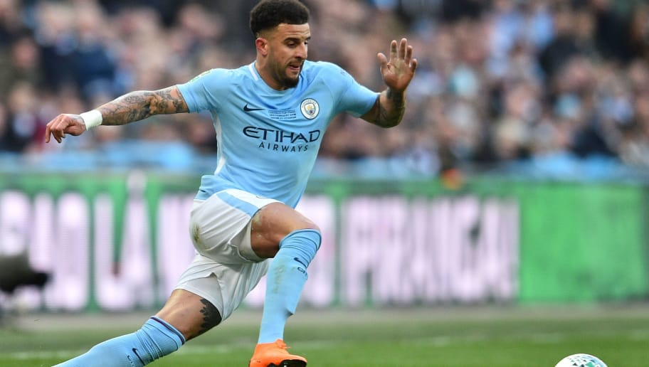 Manchester City's English defender Kyle Walker runs with the ball during the English League Cup final football match between Manchester City and Arsenal at Wembley stadium in north London on February 25, 2018. / AFP PHOTO / Glyn KIRK / RESTRICTED TO EDITORIAL USE. No use with unauthorized audio, video, data, fixture lists, club/league logos or 'live' services. Online in-match use limited to 75 images, no video emulation. No use in betting, games or single club/league/player publications.  /         (Photo credit should read GLYN KIRK/AFP/Getty Images)