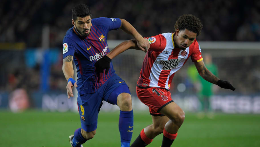 Barcelona's Uruguayan forward Luis Suarez (L) vies with Girona's Brazilian midfielder Douglas Luiz during the Spanish league football match between FC Barcelona and Girona FC at the Camp Nou stadium in Barcelona on February 24, 2018. / AFP PHOTO / LLUIS GENE        (Photo credit should read LLUIS GENE/AFP/Getty Images)