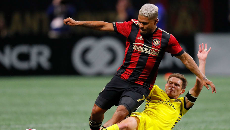 ATLANTA, GA - OCTOBER 26:  Will Trapp #20 of Columbus Crew challenges Josef Martinez #7 of Atlanta United during the Eastern Conference knockout round at Mercedes-Benz Stadium on October 26, 2017 in Atlanta, Georgia.  (Photo by Kevin C. Cox/Getty Images)