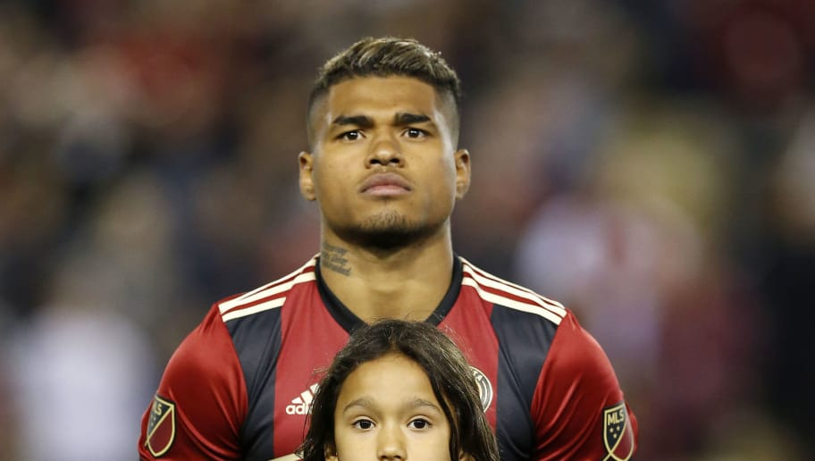ATLANTA, GA - MARCH 05: Forward Josef Martinez #7 of Atlanta United stands with a young fan for the national anthem before the game against the New York Red Bulls at Bobby Dodd Stadium on March 5, 2017 in Atlanta, Georgia. (Photo by Mike Zarrilli/Getty Images)