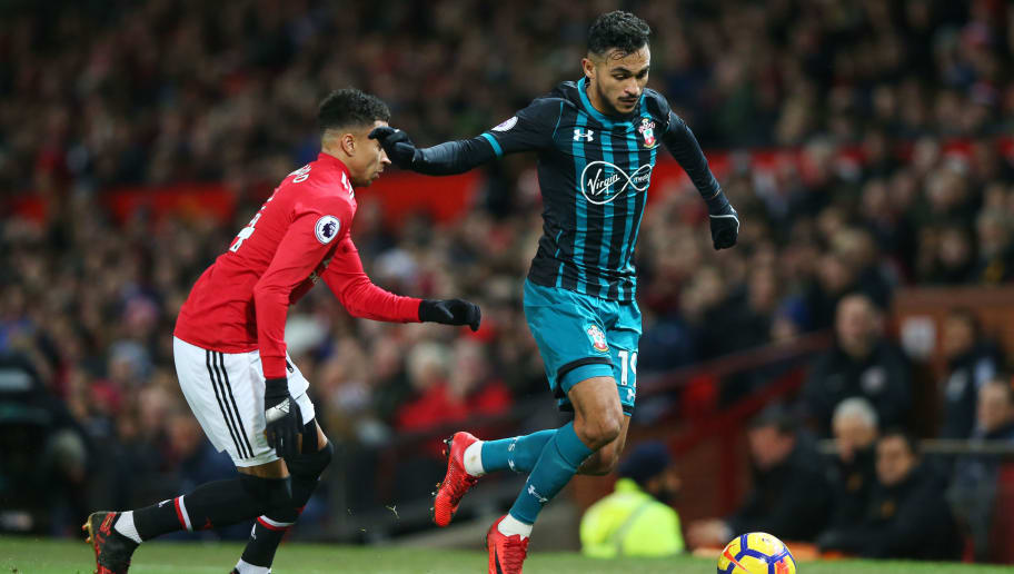 MANCHESTER, ENGLAND - DECEMBER 30:  Sofiane Boufal of Southampton is watched by Jesse Lingard of Manchester United during the Premier League match between Manchester United and Southampton at Old Trafford on December 30, 2017 in Manchester, England.  (Photo by Alex Livesey/Getty Images)