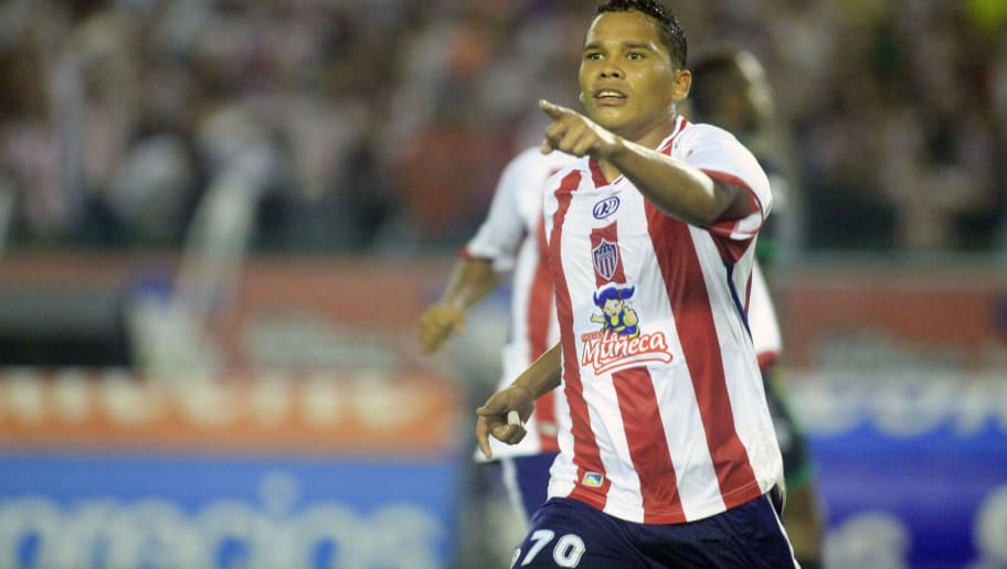Junior's Carlos Bacca celebrates after scoring against La Equidad during the Colombian Soccer League final match in Barranquilla on June 02, 2010. Junior got their sixth title in the First Division Colombian League. AFP PHOTO/STR (Photo credit should read STR/AFP/Getty Images)