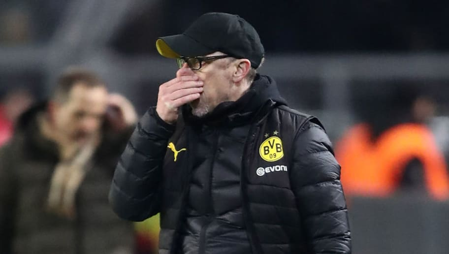 DORTMUND, GERMANY - FEBRUARY 26:  Peter Stoeger, head coach of Dortmund looks dejected during the Bundesliga match between Borussia Dortmund and FC Augsburg at Signal Iduna Park on February 26, 2018 in Dortmund, Germany.  (Photo by Christof Koepsel/Bongarts/Getty Images)