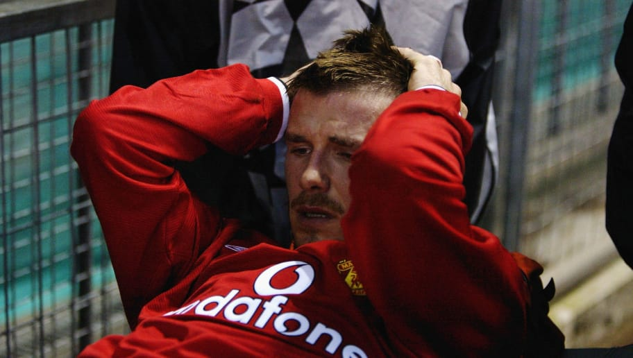 10 Apr 2002:  David Beckham of Manchester United is stretchered off after picking up a serious injury during the UEFA Champions League quarter final second leg match between Manchester United and Deportivo La Coruna played at Old Trafford, in Manchester,England. Manchester United won the match 3-2, winning the tie 5-2 on aggregate. DIGITAL IMAGE. \ Mandatory Credit: Alex Livesey/Getty Images