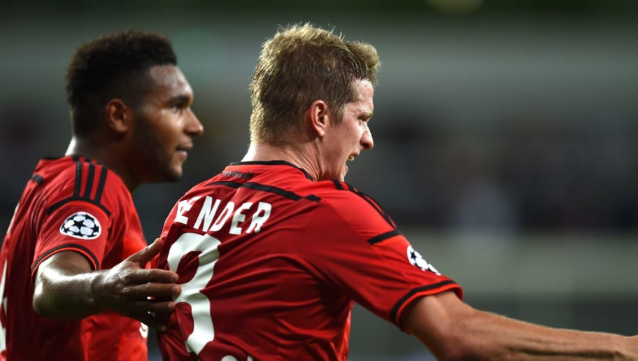 Leverkusen's defender Jonathan Glao Tah (L) and Leverkusen's midfielder Lars Bender celebrate after the UEFA Champions League second leg playoff football match between Bayer Leverkusen and SS Lazio in Leverkusen, western Germany, on August 26, 2015.  Leverkusen wins 3-0. AFP PHOTO / PATRIK STOLLARZ        (Photo credit should read PATRIK STOLLARZ/AFP/Getty Images)